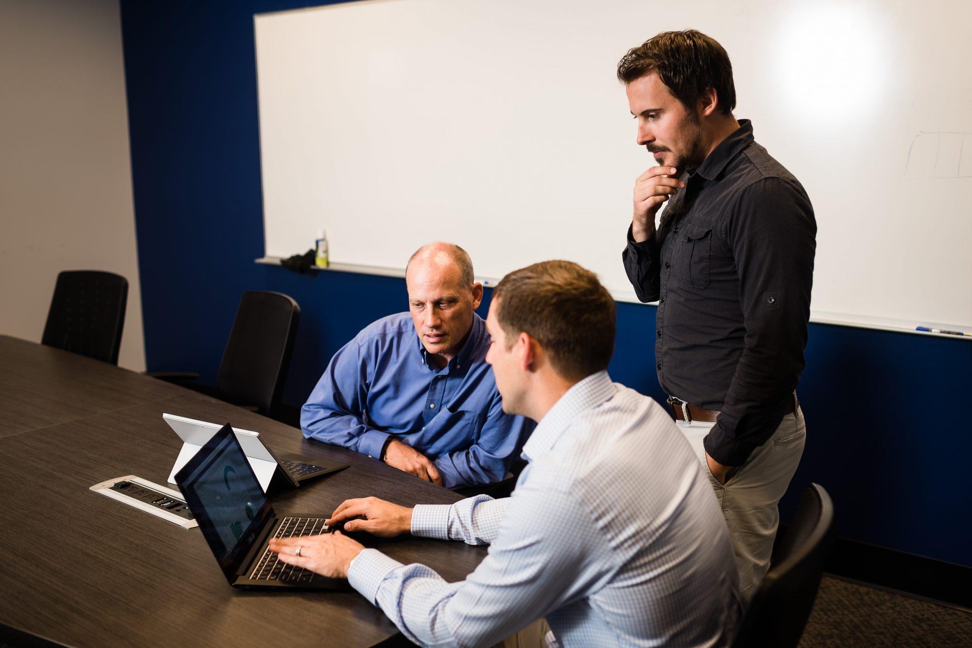 3 men testing ux design changes on a laptop